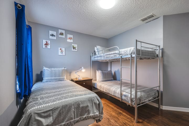 """Pixar Themed Room with a Bunk Bed, a Single Bed and 32"""" Smart TV."""