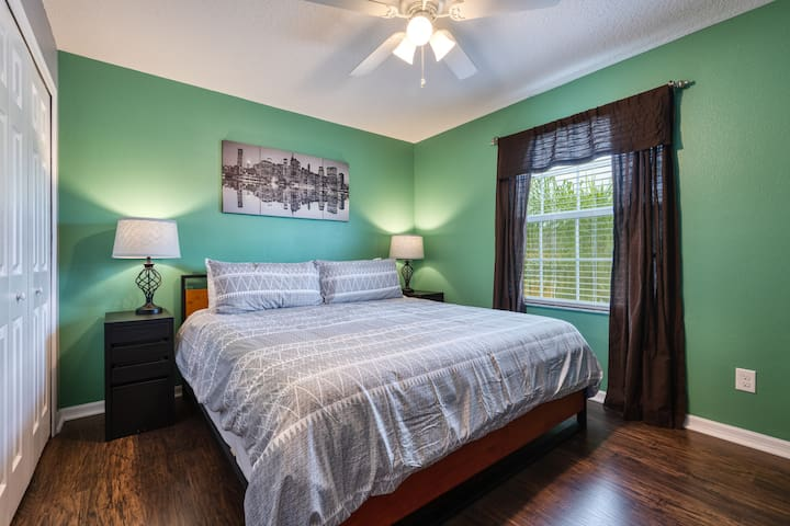 """First King Bedroom with closet, King Size Bed, Ceiling Fan and 50"""" Smart TV"""