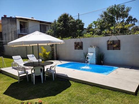 Casa Setiba frente para o mar (4 suítes e piscina)