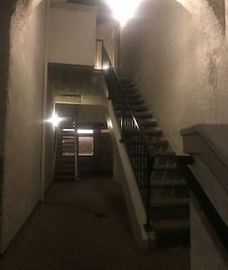 Well lit path up the stairs on the right for my home