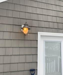 House has exterior lighting
