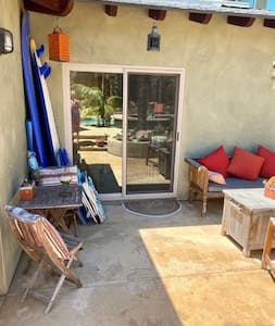 The pictures are in reverse.  This is the entrance to the Airbnb room.  It's a private double pane sliding door that faces towards the spa, pool and backyard.