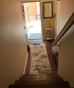 There is a nice size entrance, however we do have one and a half sets of steep stairs leading to the main level.
