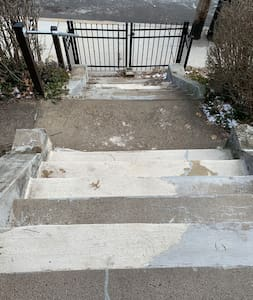 14 steps to front door.   4 foot sidewalks and street lighting all around the house to the approach