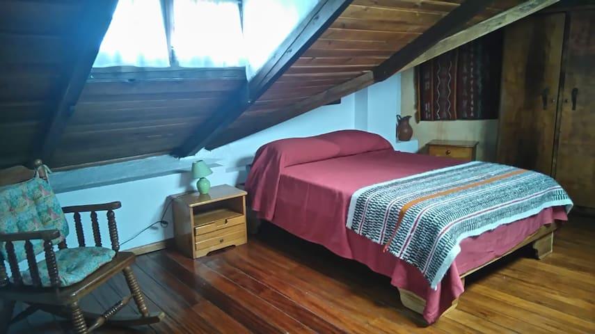 Dormitorio suite uno
