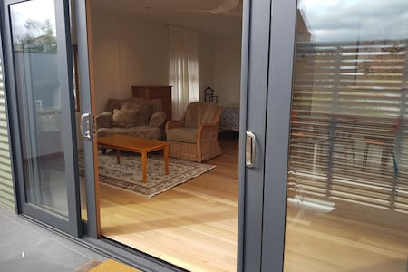 Double sliding doors from patio into studio