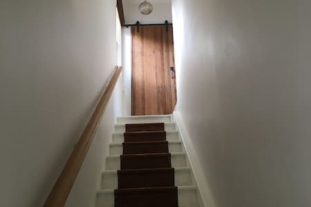 There are 12 stairs to enter the apartments main living area.