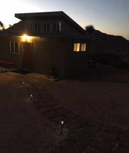 Light over doorway automatically turns on at dusk, as do solar lights leading from property entrance up driveway to front door.
