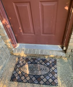 Other than this small increase in Heights to get in the door all the ground is flat. If you want to go out into the side yard you do have to go downstairs otherwise the rest of the house is totally flat