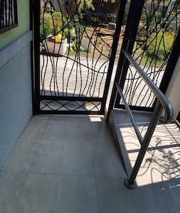 PWD entry way and gate for wheelchair-bound/user guests.  The ramp has handle bars on left for support and comfort.