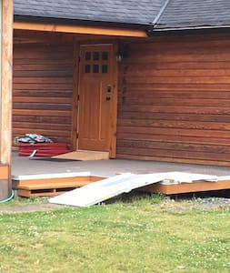 Adjustable Metal Ramp and a Wood ramp to enter the home