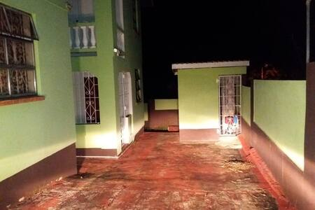 Well-lit pathway and entrance to Island GetAway apartment