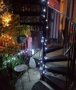 spiral stairs are lit to the room and around the walk way.