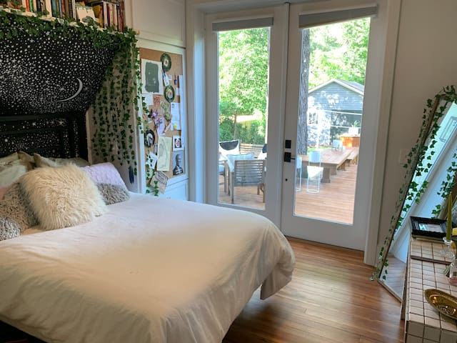 Full-size bed with French doors that open onto the back deck.
