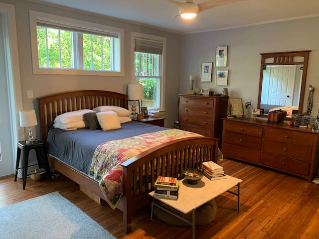 Queen-size bed with door onto the back deck and bathroom access.