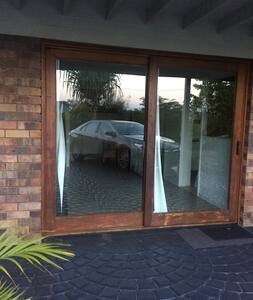 Entrance through wide door from driveway to front entrance