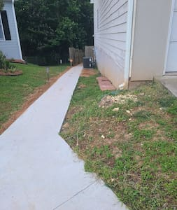 paved pathway from driveway to doorway