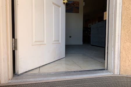 Flat entry through front door. No stairs into or inside the property