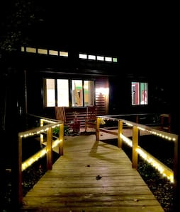 Entrance ramp from parking space is lighted at night.