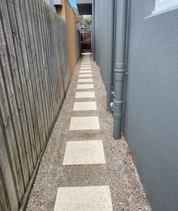 Path leading to front door of apartment no steps at all. No steps into apartment & no steps inside apartment. Walk in shower also