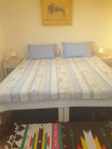 double bed in bedroom 3 made up with 2 single bed .