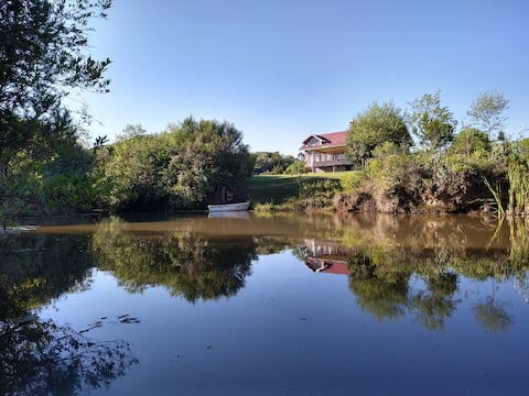 Cammplot view of Mount Kenya, a pond & a boat