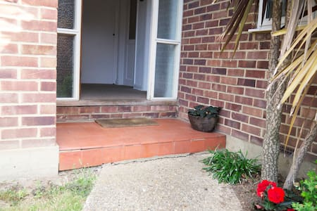 Flat concrete path to front door, 2 x steps up into property