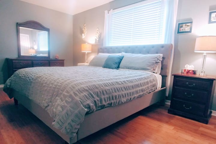 Spacious master bedroom with luxurious king bed and plenty of closet space.