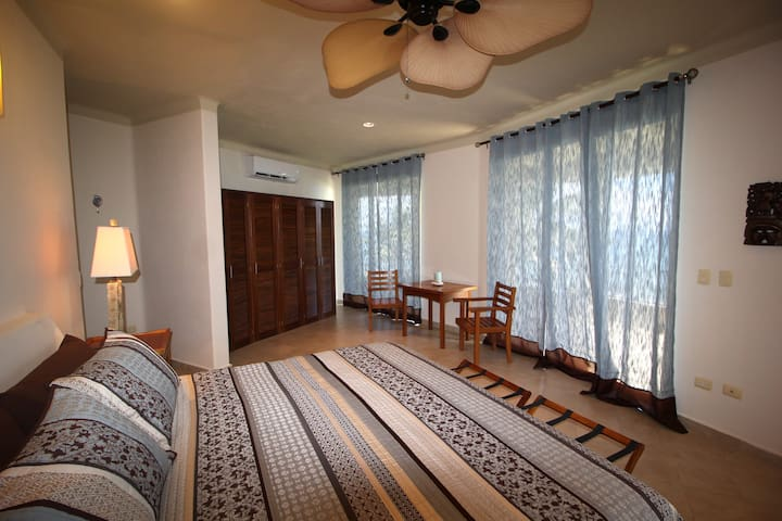 Spaciouss master bedroom provides king size bed with large built in closet with ample storage. Large sliding glass doors provide access to private balcony.  Comfortable furnishings provided that can be easily moved to outdoor spaces.