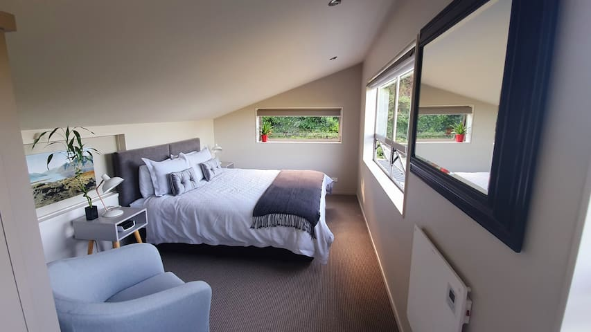 Loft-style bedroom with large comfortable bed for a restful nights sleep.
