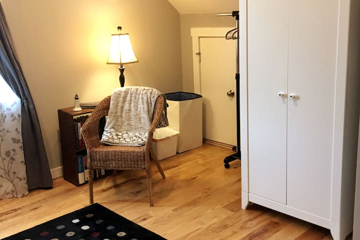 The bed area offers a seat, hanging space, and a wardrobe with space for your clothes and extra towels.