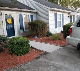 Walkway from parking pad to the front door