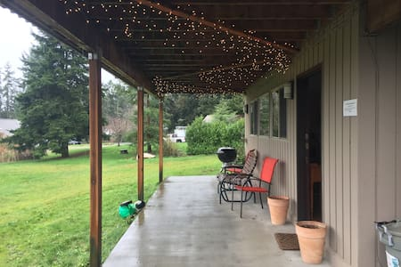 There are twinkle lights all along the patio, as well as wall sconces.  Parking for the guest residence is immediately adjacent to the patio.