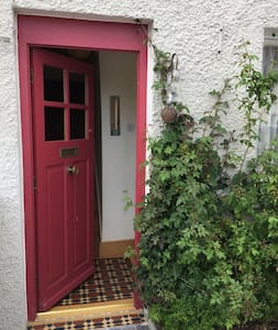 """Flat path to the door, but the door is 28"""" with another door at an angle within. And stairs to access bedrooms."""