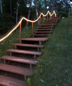 Stairs down from the road are lighted.