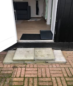 Door is wider than 80 cm. The top is step is about 15 cm high
