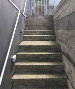 13 steps to the front door in total. Riser 190 x 270 tread. Fully compliant with NZ Standards. There is a landing part way up. The gate opens either way for accessibility. The steps are lit.