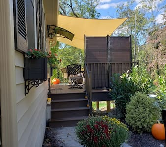 Private deck entrance had paver walkway.  Deck doorway light stays on 24/7 and the driveway and parking area lights are motion activated