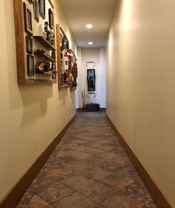 Hallway ramp provides no-step access between the gathering room and the dining/living area for guests.