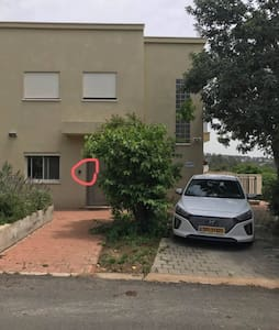 This is the entrance of the apartment, in the left you can see the locker box and in the right the parking.