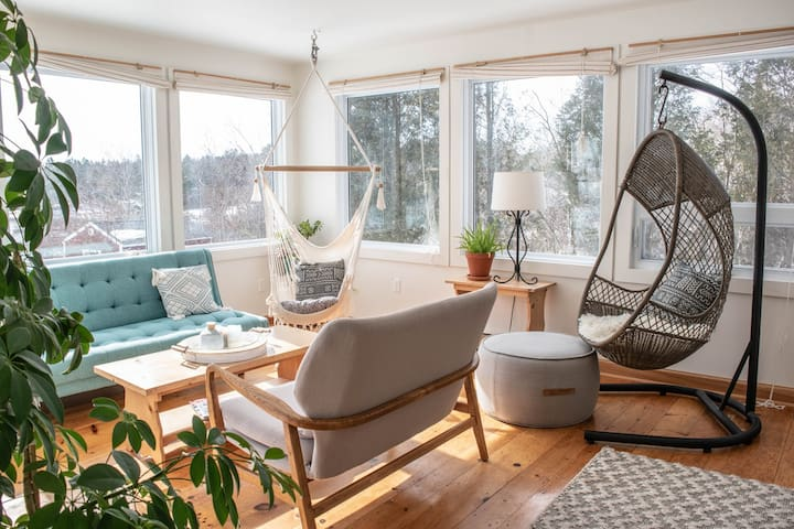 Sunroom and small sofa bed. Rearrange the furniture for a yoga space or an intimate conversation are filed with light all day. Big decks are just off the sliding if glass door with deck furniture. Group yoga or lounging in the sun!