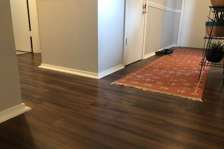 Entryway/hallway to guest room and guest bathroom.