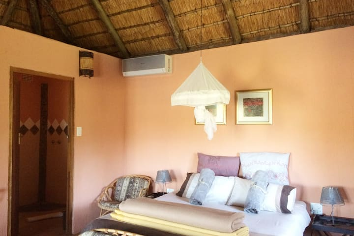 Welcome to self contained private cottage with large double bed, little kitchenette, en-suite bathroom, private barbecue area, veranda with river view and access to a big swimming pool.
