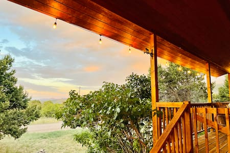 Walkway to cabin and front porch with hanging overhead lights
