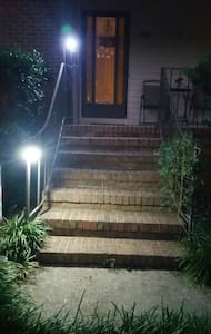 Night time - steps to main entrance.