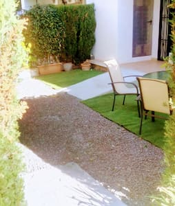 the path is flat but on gravel, we have installed two gentle concrete ramps to access the apartment at the rear terrace through the sliding doors. it is accessible by the narrower wheelchairs, standard buggies and roller/Zimmer frames.