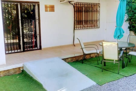 the terrace at the back is accessed by ramps, the rejas (wrought iron doors) swing fully open, the entrance is over the 1.5cm loop of the sliding door, which is 75cm wide.
