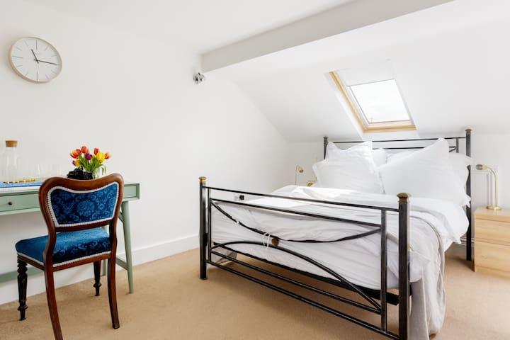 Attic bedroom with ensuite bathroom.