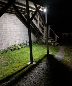 The motion sensor light comes on when you drive in and also when you take your first step down from the top of the stairs.