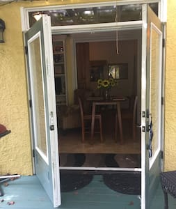 Double French doors with invisible screen available. Frame surrounds entrance. Approximately 2 inches tall.